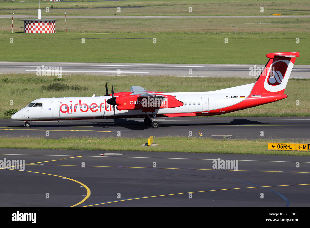 German LGW Bombardier Dash 8 Q400 in Air Berlin livery with registration D-ABQB on taxiway of Dusseldorf Airport. - Stock Image