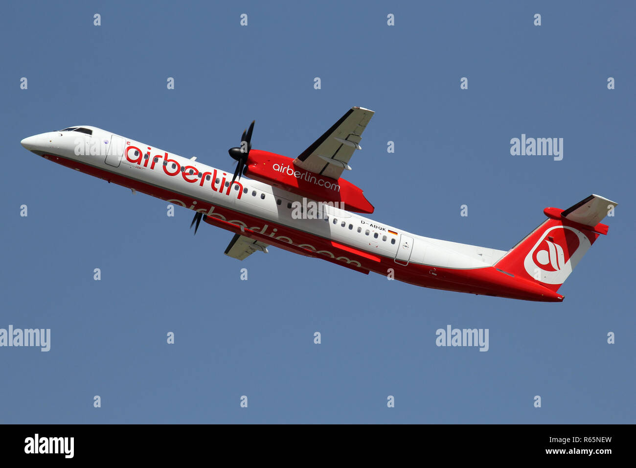 German LGW Bombardier Dash 8 Q400 in Air Berlin livery with registration D-ABQK just airborne at Dusseldorf Airport. - Stock Image