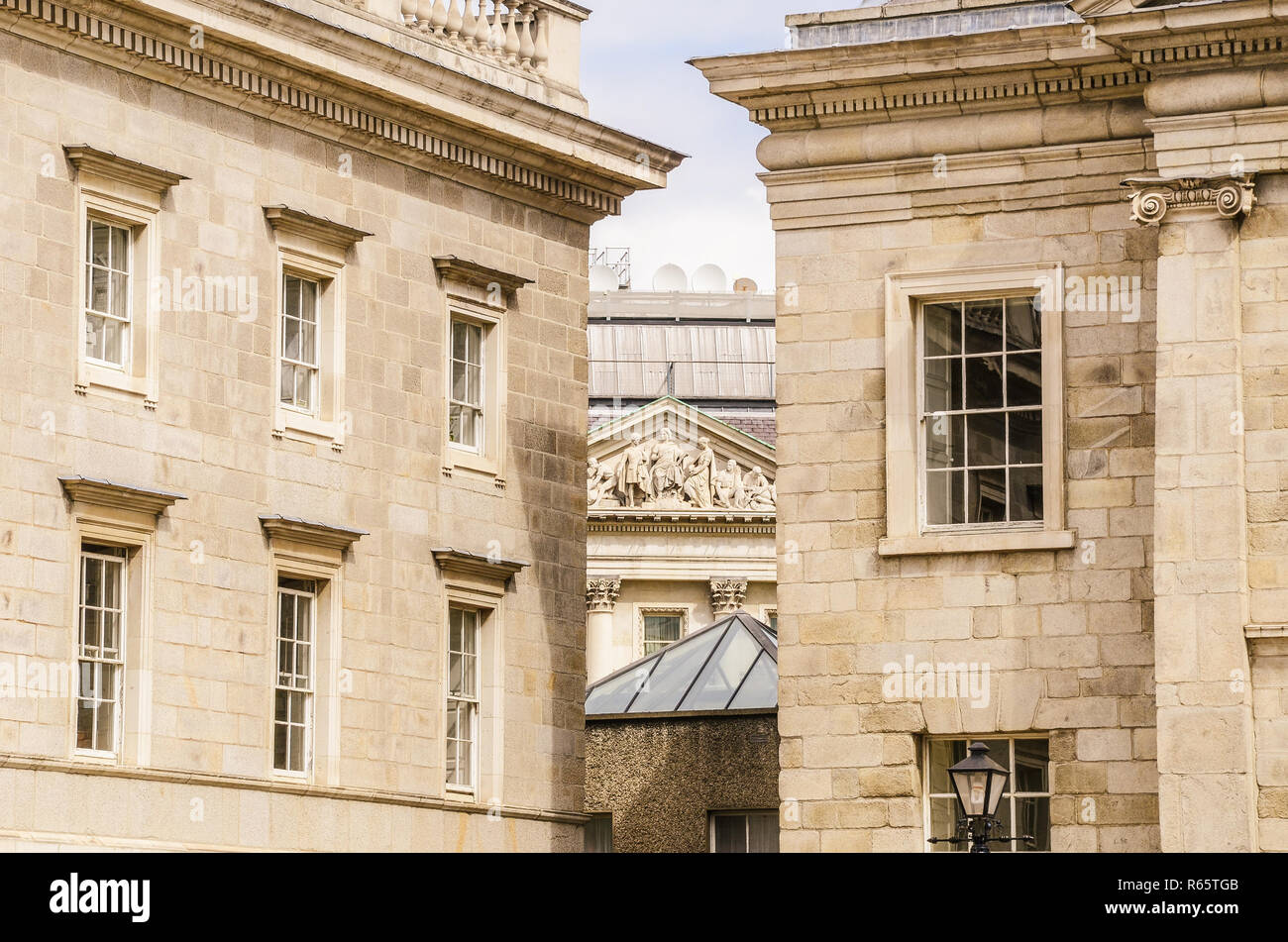 Elegant buildings with classical architecture on a college campus - Trinity College in Dublin, Ireland - Stock Image