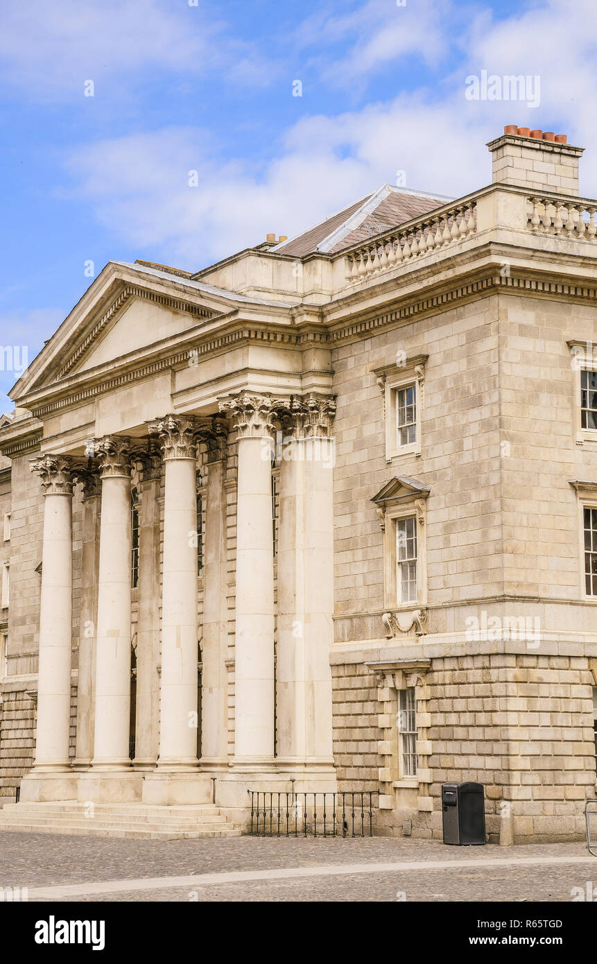 Elegant building with Corinthian columns and portico at Trinity College in Dublin, Ireland - Stock Image