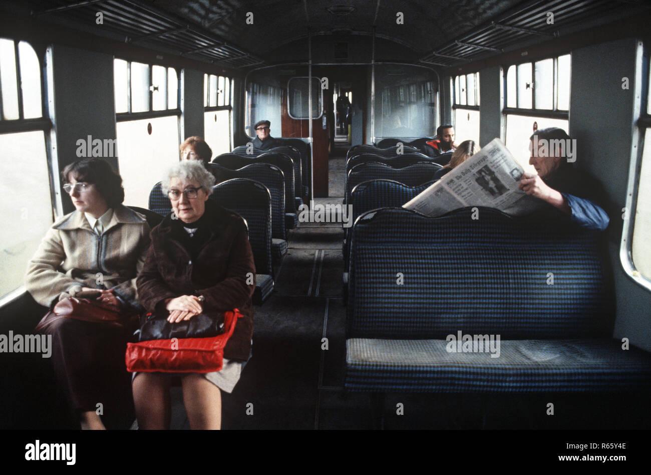 Railway passengers on the British Rail Preston to Colne railway line, Lancashire, Great Britain - Stock Image
