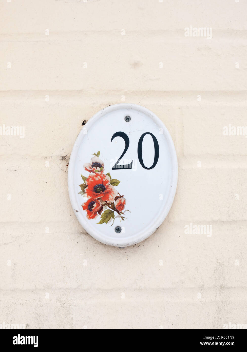 House Number Plate On Outside White Wall 20 Flower Design