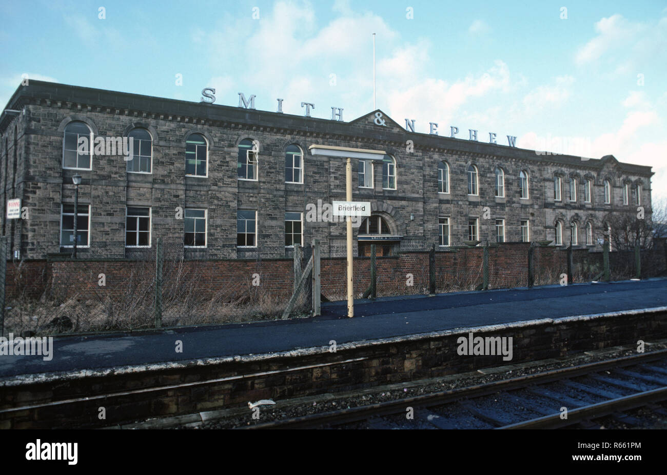 Smith and Nephew Mill at Brierfield on the British Rail Preston to Colne railway line, Lancashire, Great Britain - Stock Image