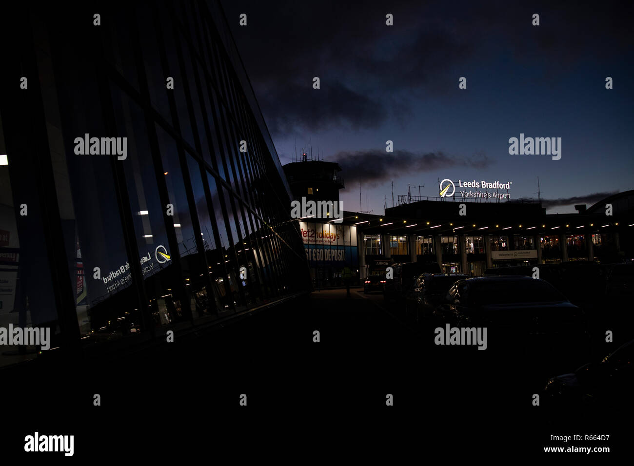 The welcome to Leeds & Bradford Airport sign at LBA. Night time & Daytime - Stock Image