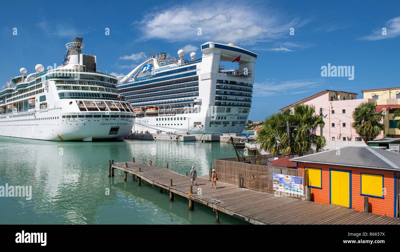 Royal Caribbean Grandeur of the Seas and Caribbean Princess cruise ships at St. John's Antigua - Stock Image