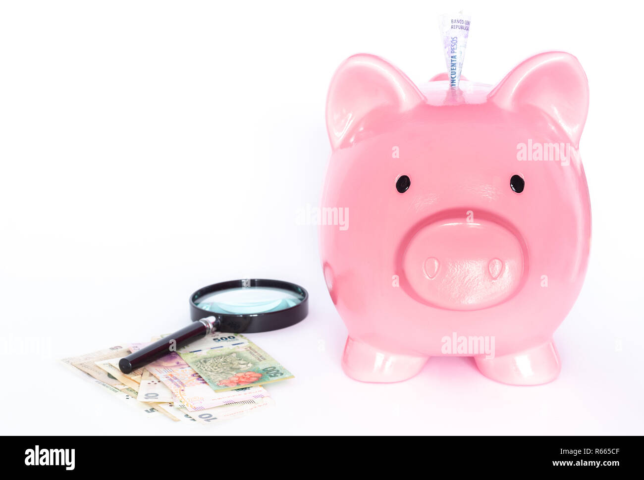 Argentine money, peso and piggy moneybox - Stock Image