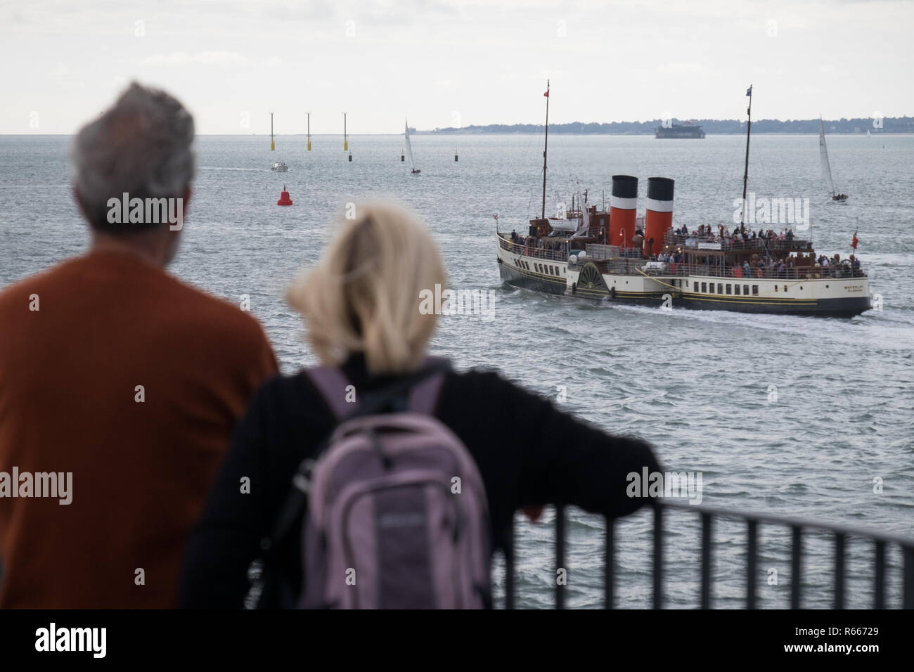 PS Waverley, the world's last seagoing paddle steamer sailing out of Portsmouth Harbour on an excursion to Weymouth - Stock Image