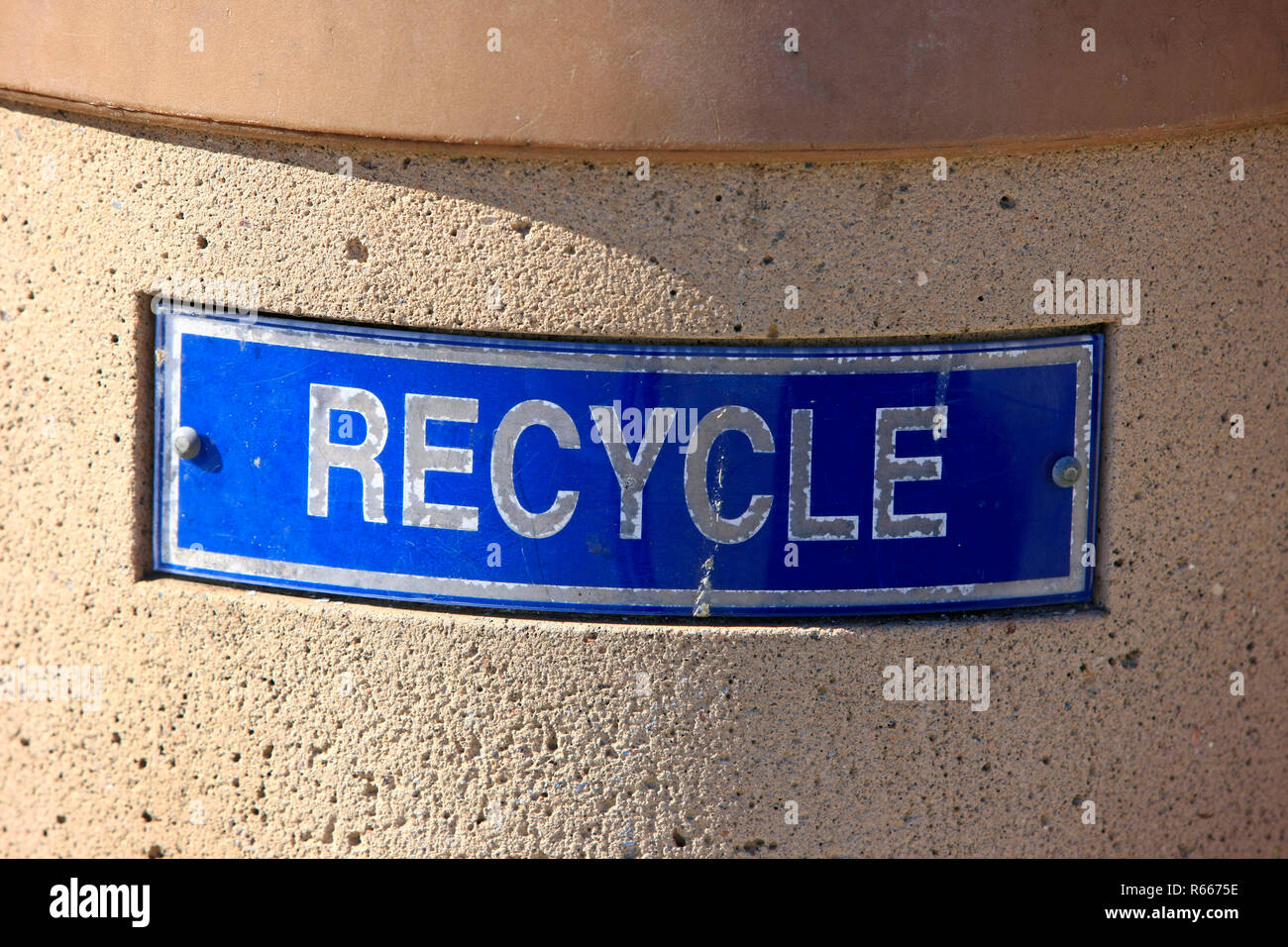 Close up of a RECYCLE sign on a trash can - Stock Image
