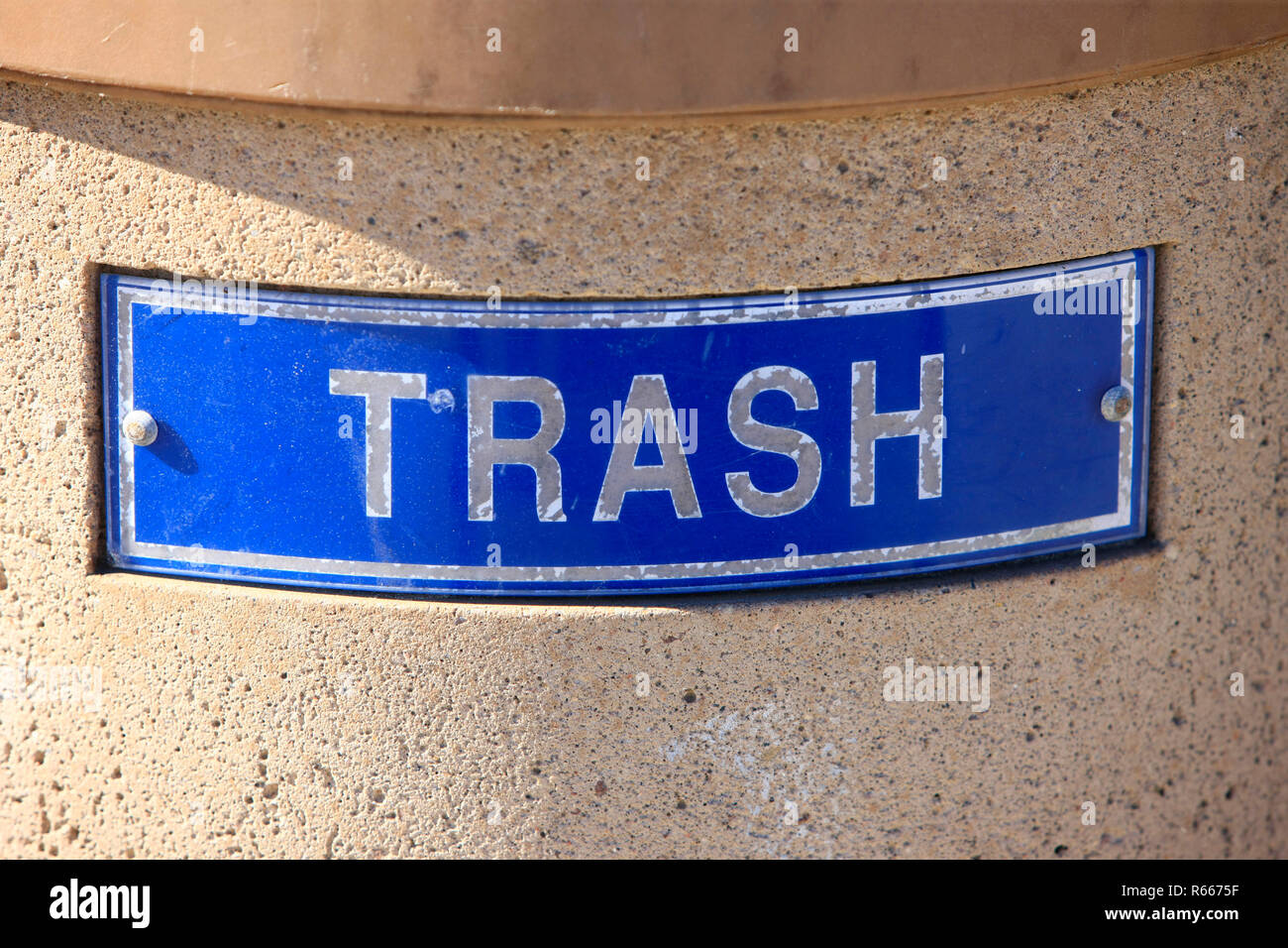 Close up of a TRASH sign on a trash can - Stock Image