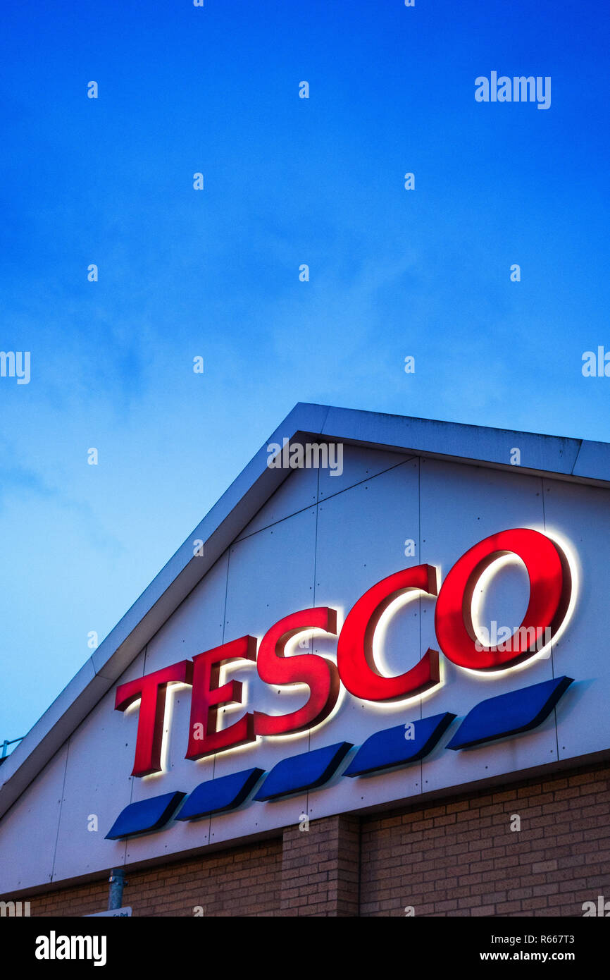 illuminated Tesco Sign at dusk in Dinnington, Rotherham UK - Stock Image
