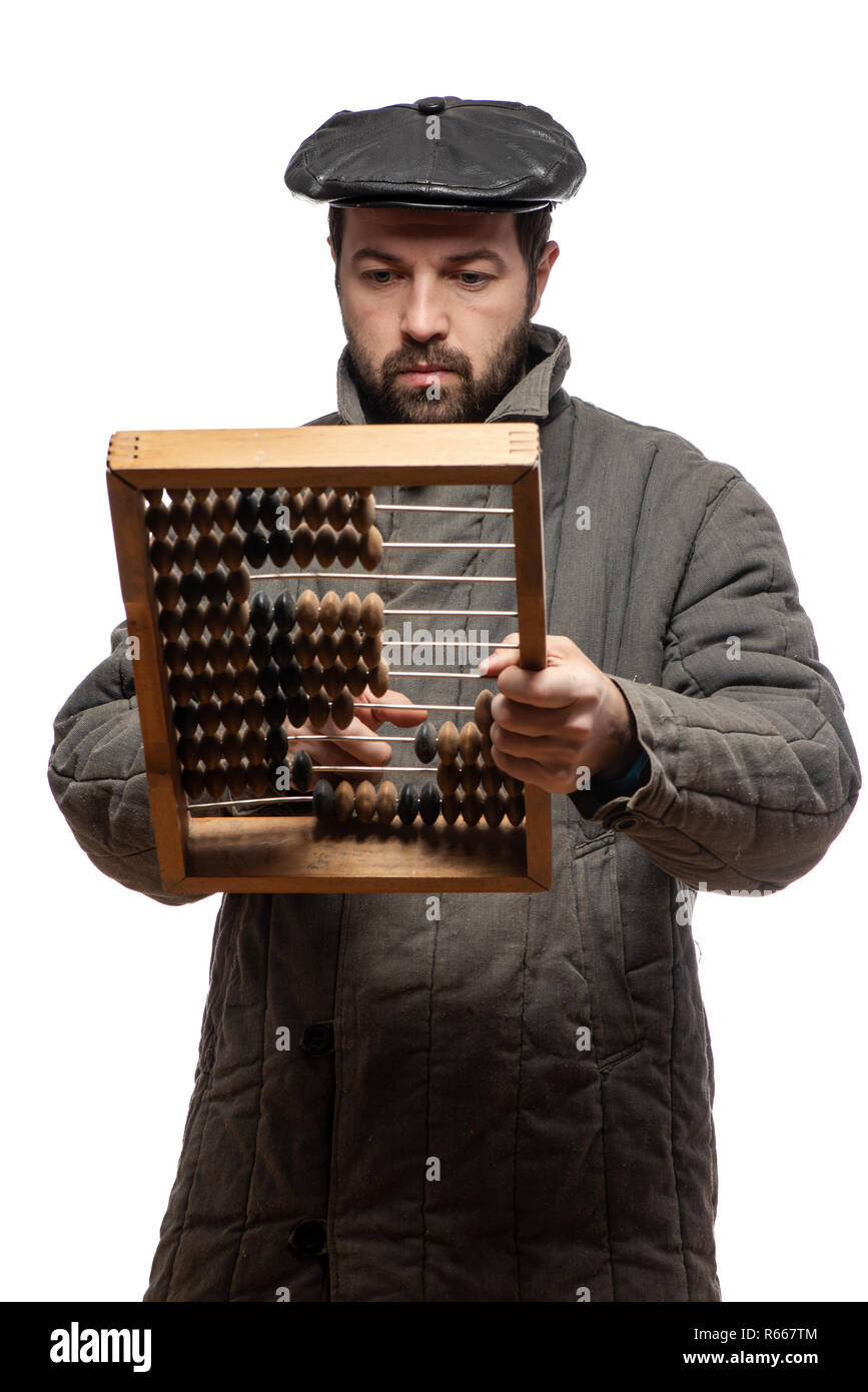 Old fashioned bearded man counts on retro wooden abacus, studio shot. Isolated on white background, with clipping path - Stock Image