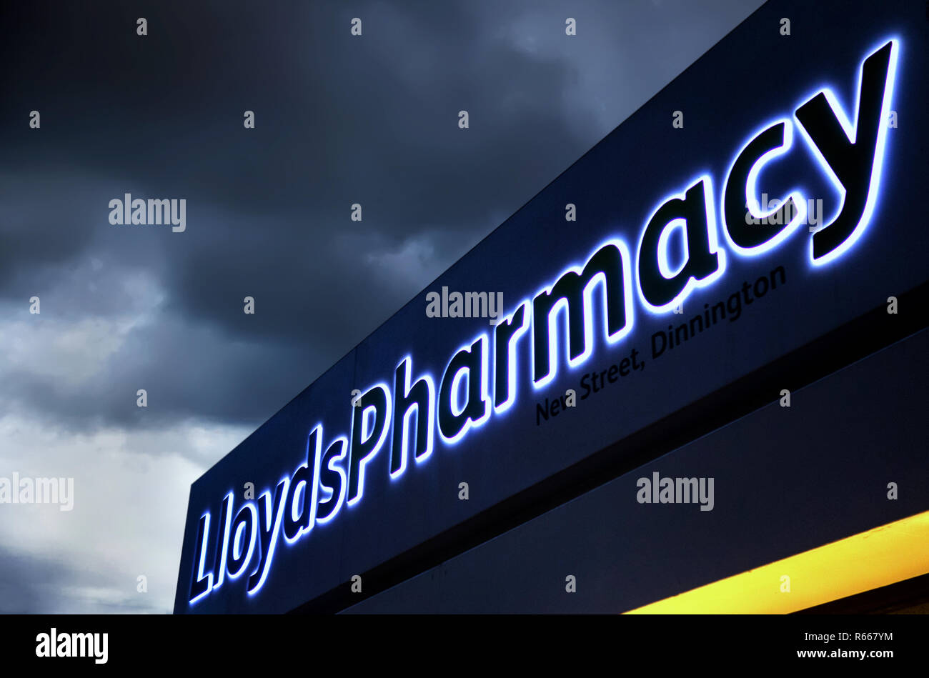 illuminated Lloyds chemist sign at dusk in Dinnington, Rotherham UK - Stock Image