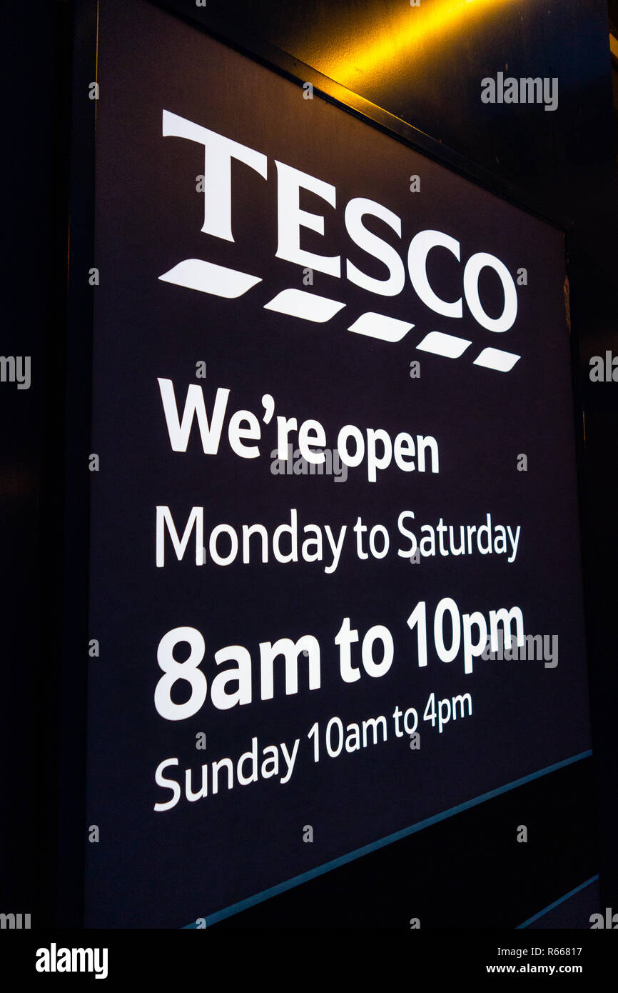 We are Open sign at Tesco Supermarket at Dinnington, Rotherham, South Yorkshire - Stock Image