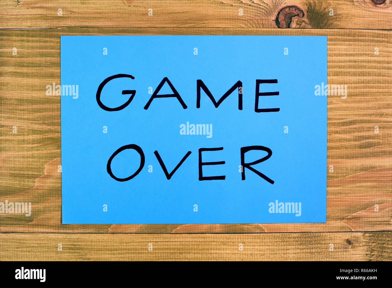 Text game over on wooden table,relationship breakup concept. - Stock Image