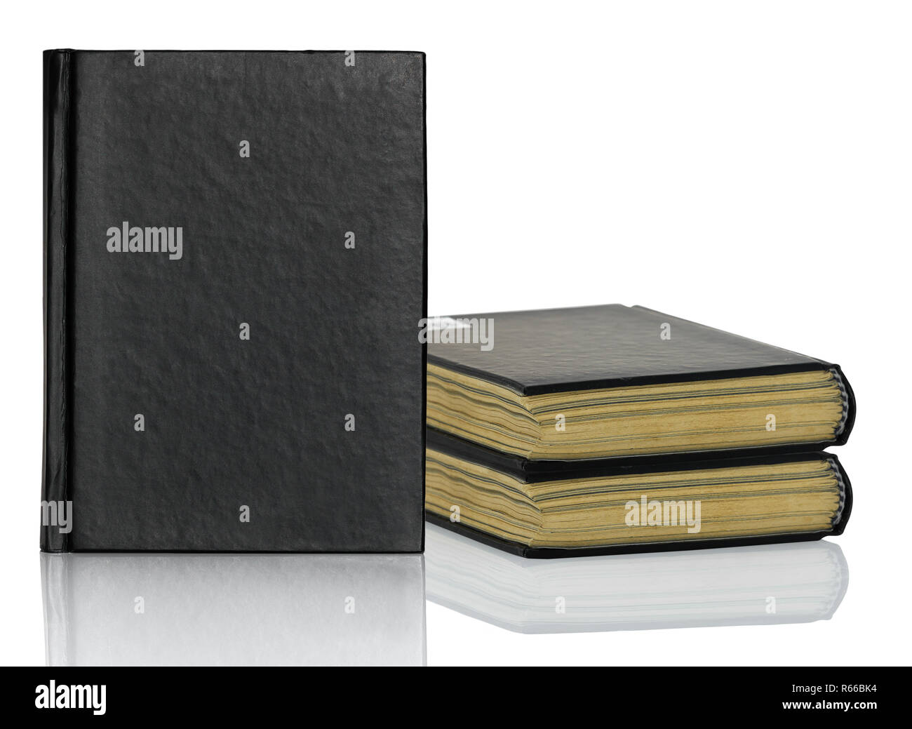 Closed black book with shadow on white background - Stock Image