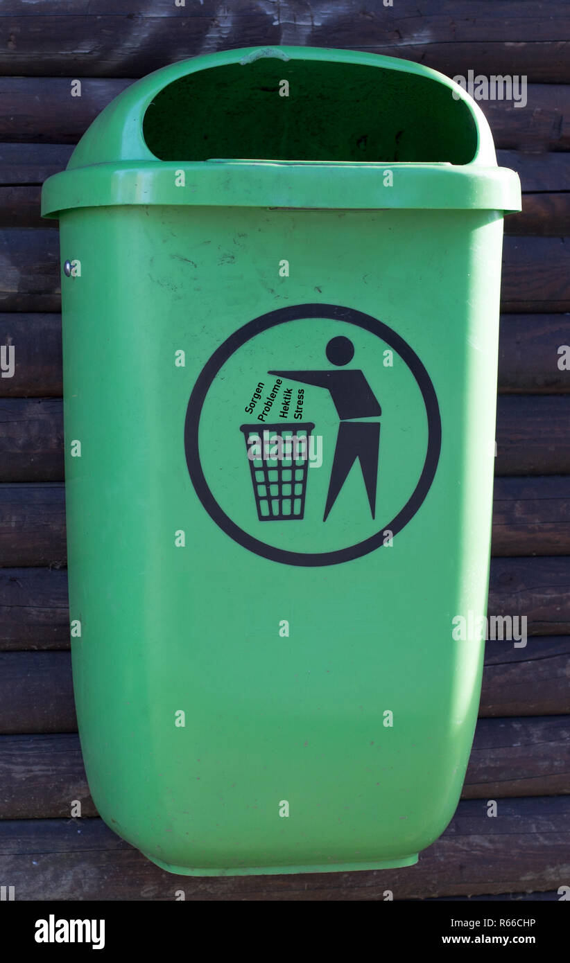 green trashcan for worries,problems,hectic,stress - Stock Image