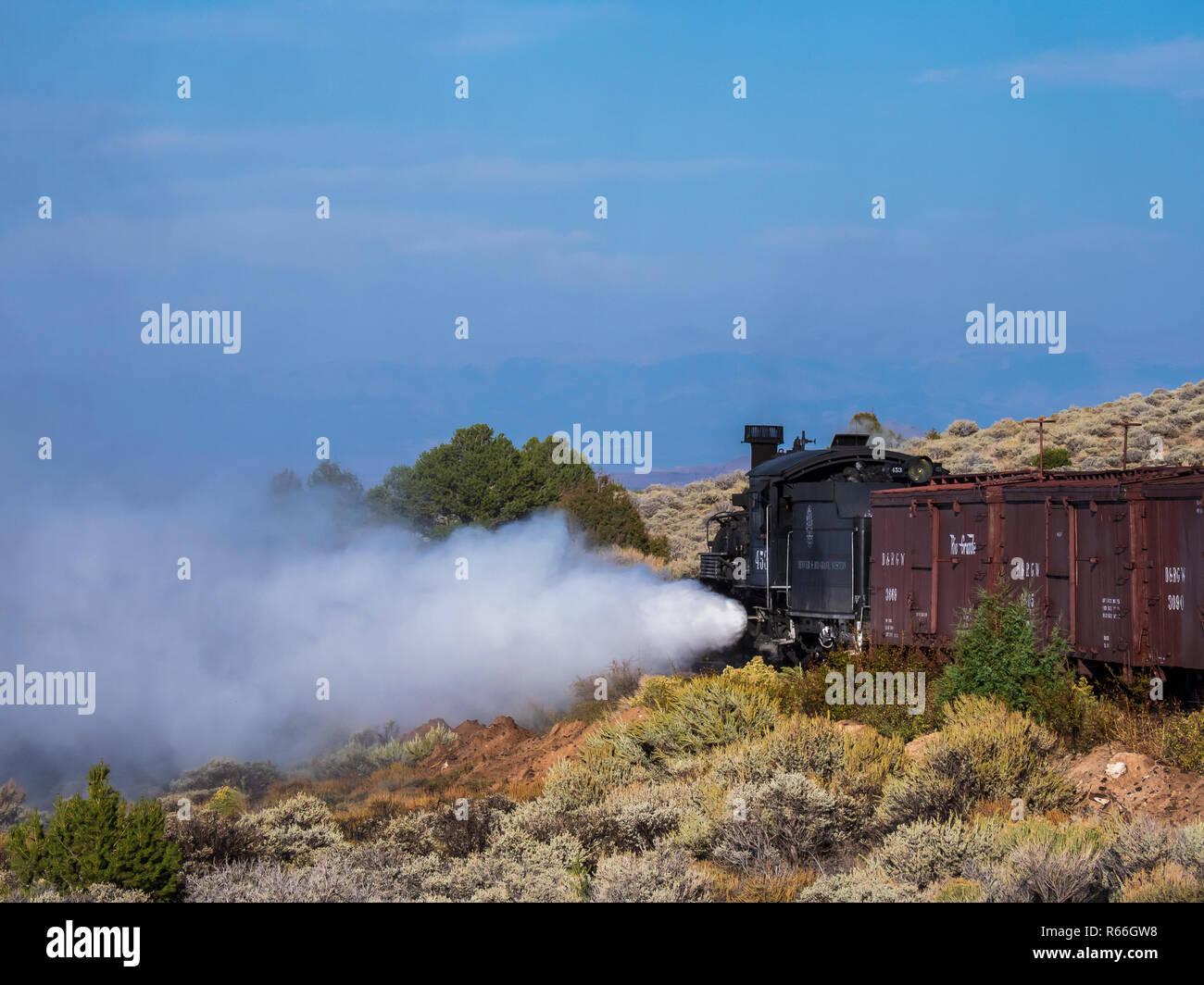 Locomotive 453 steam-engine freight train lets of steam, Cumbres & Toltec Scenic Railroad, Antonito, Colorado. - Stock Image
