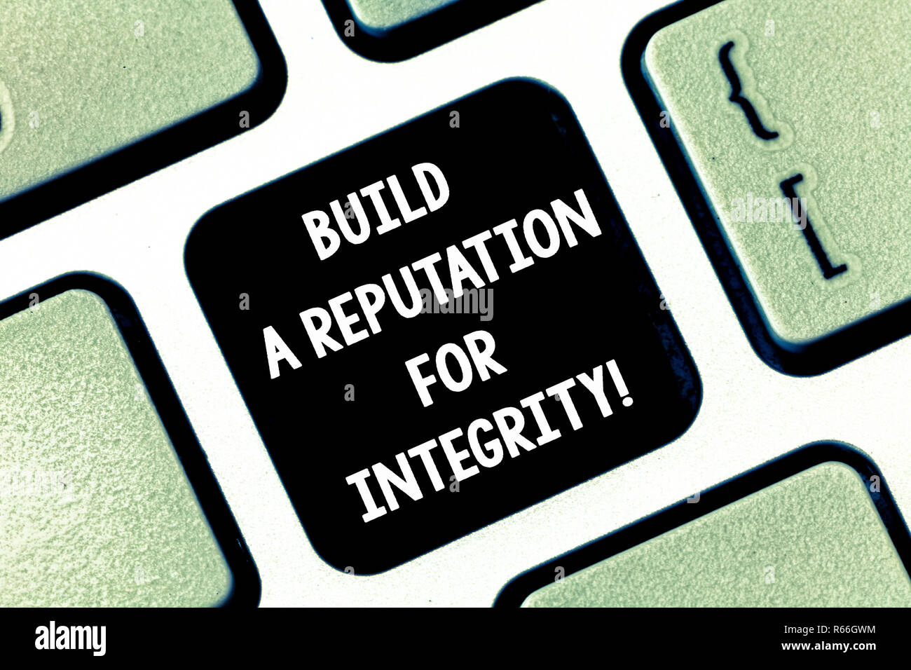 Conceptual hand writing showing Build A Reputation For Integrity. Business photo text Obtain good feedback based on ethics Keyboard key Intention to c - Stock Image