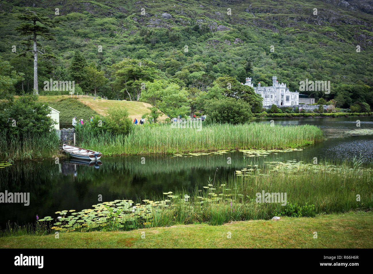 Kylemore Abbey surrounded by the woods, Galway, Ireland - Stock Image