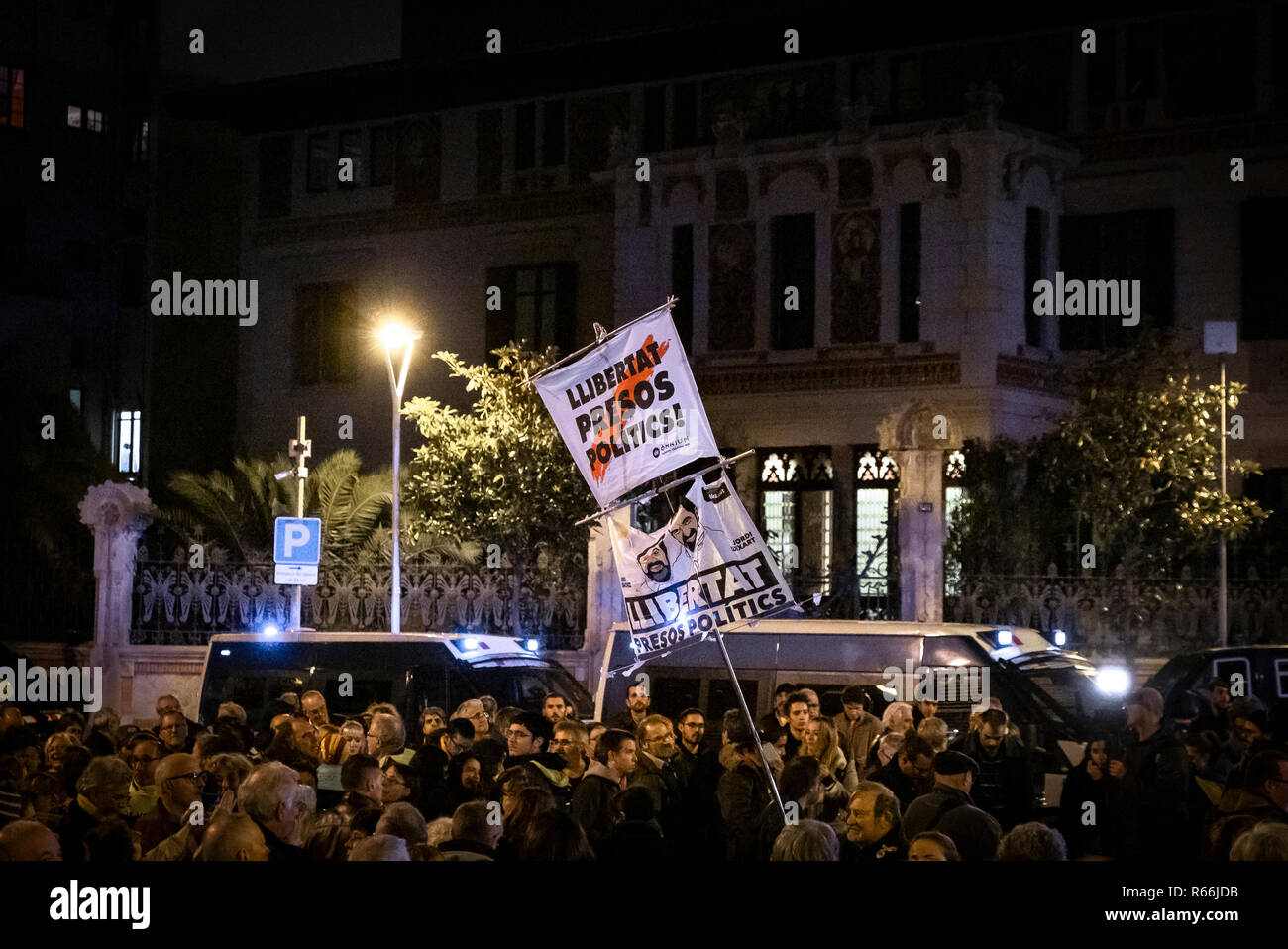 A crowd of pro-independence protesters are seen in front of the Delegation of the Government of Spain. Demonstrators took to the street of Barcelona in solidarity with the four political prisoners (Joaquín Form, Jordi Sànchez, Josep Rull and Jordi Turull) in prison who have begun an indefinite hunger strike. Stock Photo