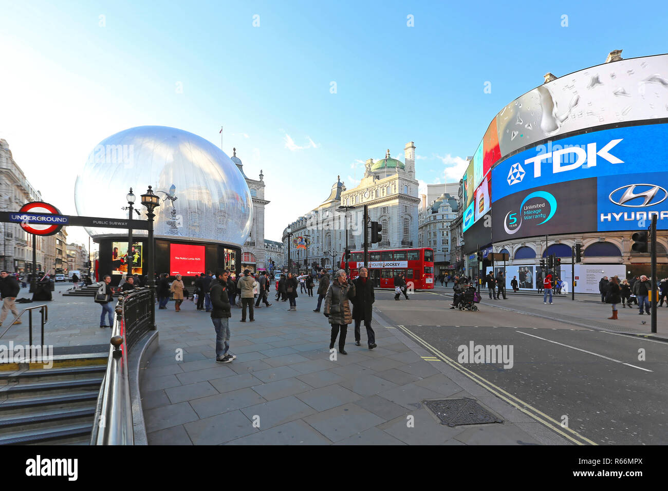LONDON, UNITED KINGDOM - NOVEMBER 19: Christmas at Piccadilly Circus in London on NOVEMBER 19, 2013. Big snow globe with Eros Statue at Piccadilly Cir Stock Photo