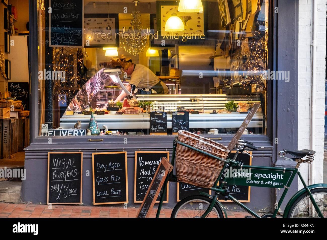 Traditional butcher with butcher's bike outside and blackboards with display window,Royal Tunbridge Wells, Kent, UK - Stock Image