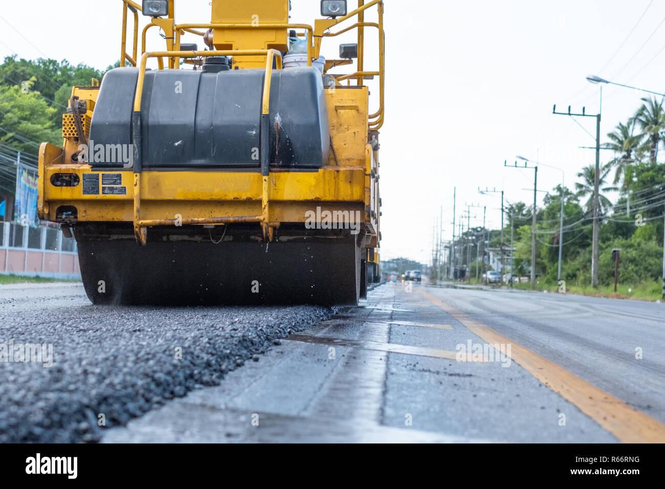Close-up of asphalt roller working on supplement of asphalt
