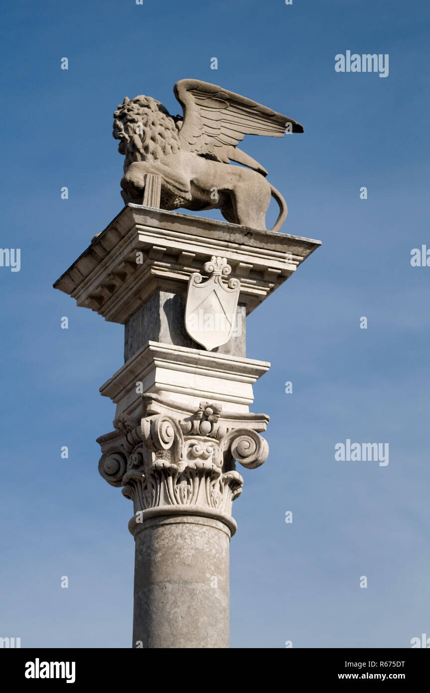 the lion of San Marco on a column in Piazza Libertà in Udine, Italy - Stock Image