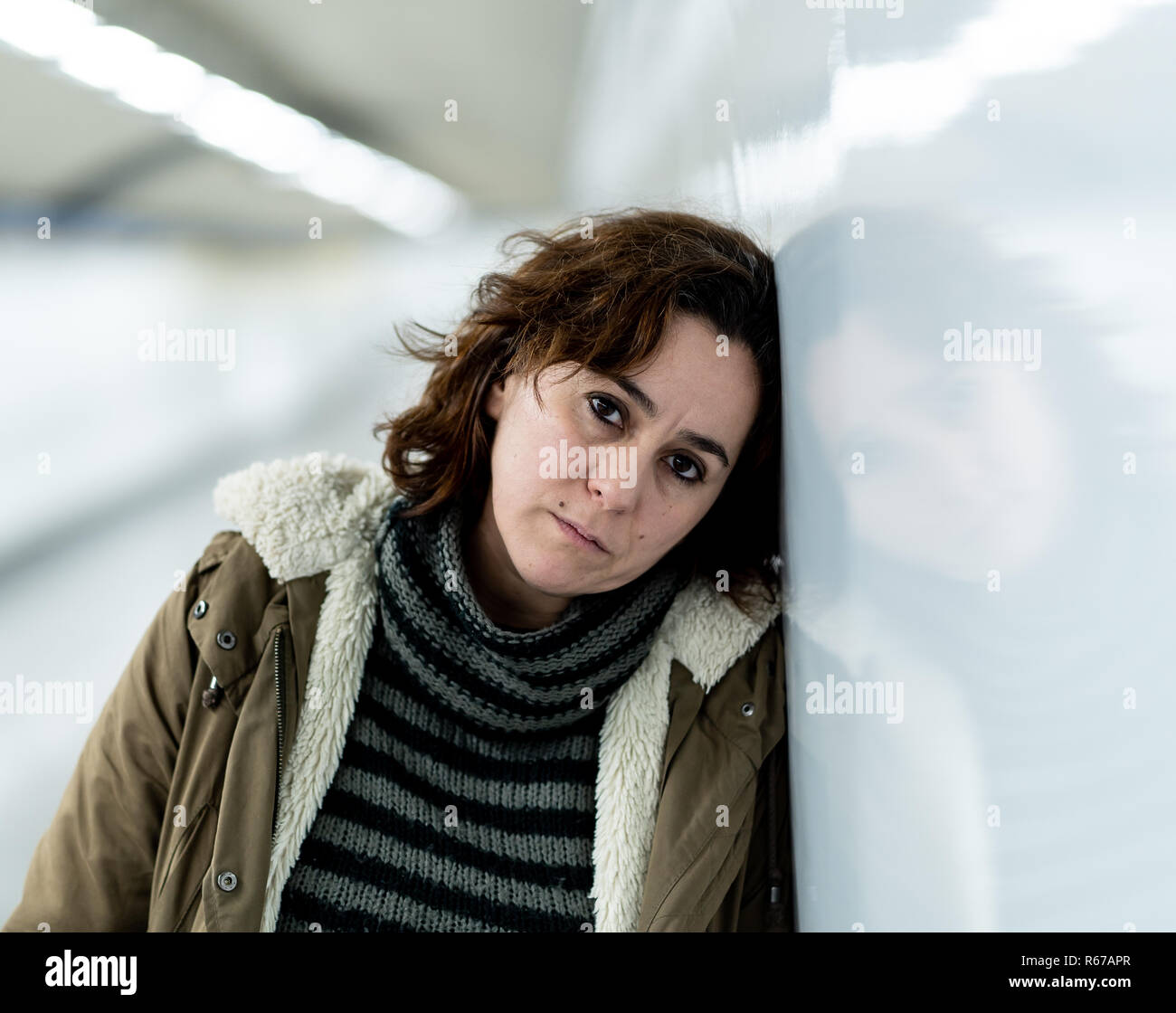 Hopeless and exhausted woman suffering depression and anxiety in subway tunnel in Work-life balance issues Negative body image Financial troubles and  Stock Photo