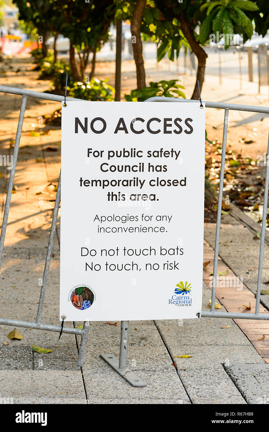 Health concern sign relating to a Spectacled flying fox or Spectacled Fruit Bat colony, Cairns, Queensland, QLD, Australia - Stock Image