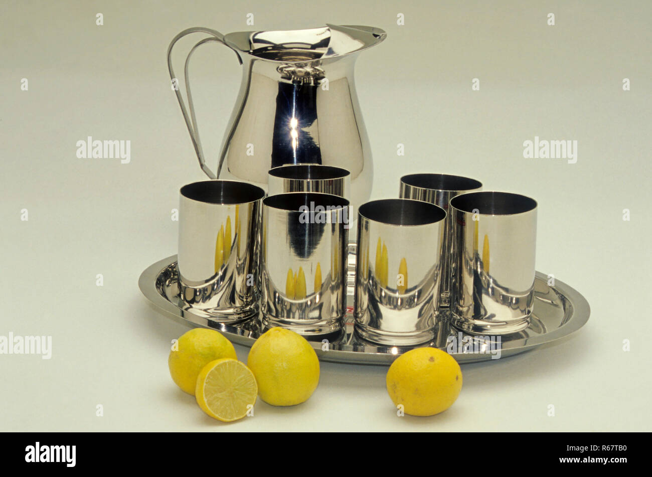Water jug and glasses, stainless steel product - Stock Image