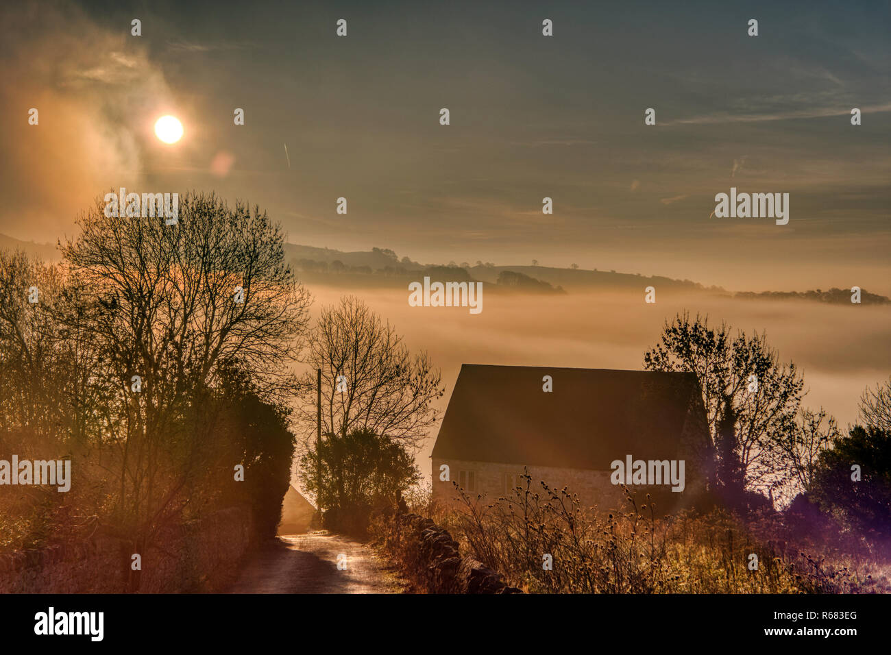 Wirksworth, UK. 03rd Dec, 2018. UK Weather: spectacular sunrise with cloud inversion at the star disc above Wirksworth in the Derbyshire Dales, Peak District National Park Credit: Doug Blane/Alamy Live News - Stock Image