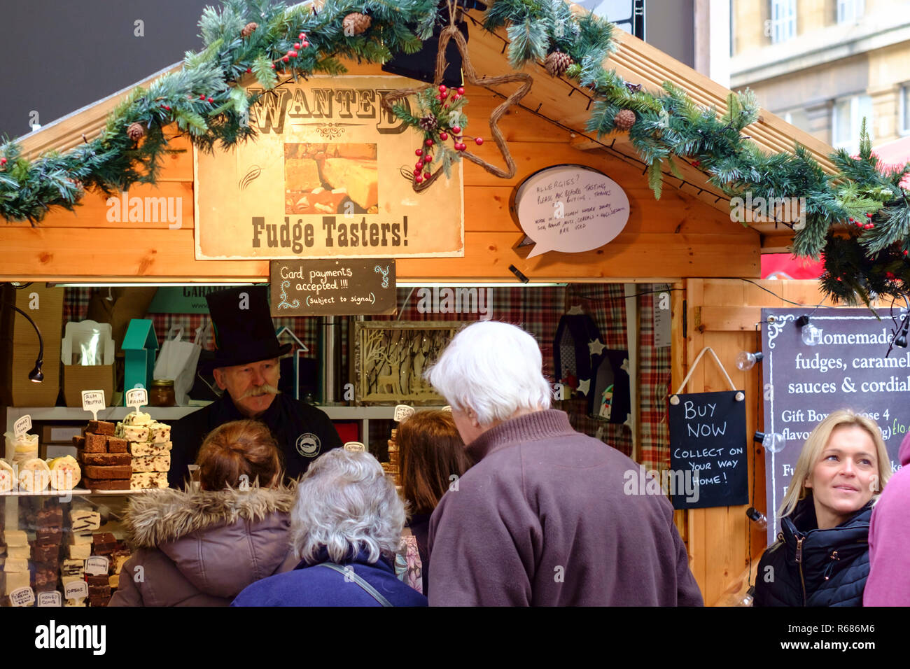 Bath, Somerset, UK. 4th Dec 2018. Pictures of a busy mid week crowd of shoppers at Bath's Christmas Market. The 2018 market is the biggest hosted by the city of Bath. As well as the Abbey courtyard and narrow streets surrounding the Roman Baths, this year Milsom Street has also been set aside for market stalls. The market closes on 9th December, the organisers may consider an extension of the license for a further week in 2019. Credit: Mr Standfast/Alamy Live News - Stock Image