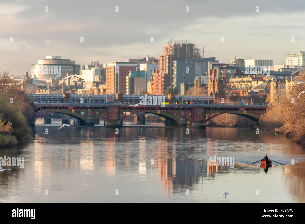 Glasgow, Scotland, UK. 4th December, 2018. UK Weather. George Parsonage together with a colleague from the Glasgow Humane Society rowing on a calm River Clyde on a cold, sunny afternoon. Credit: Skully/Alamy Live News - Stock Image