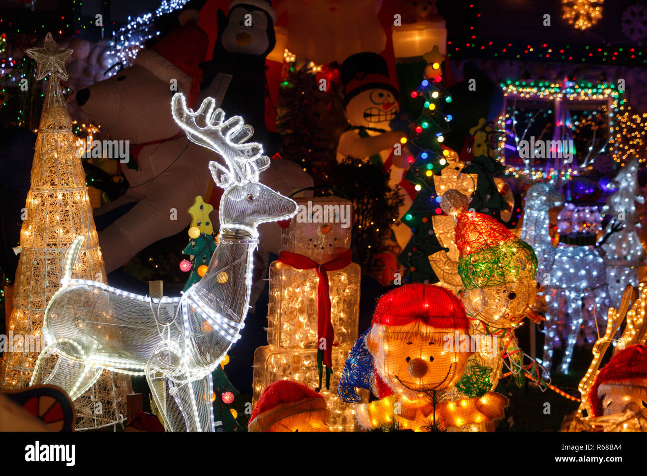 Christmas decorations in front of a house - Stock Image