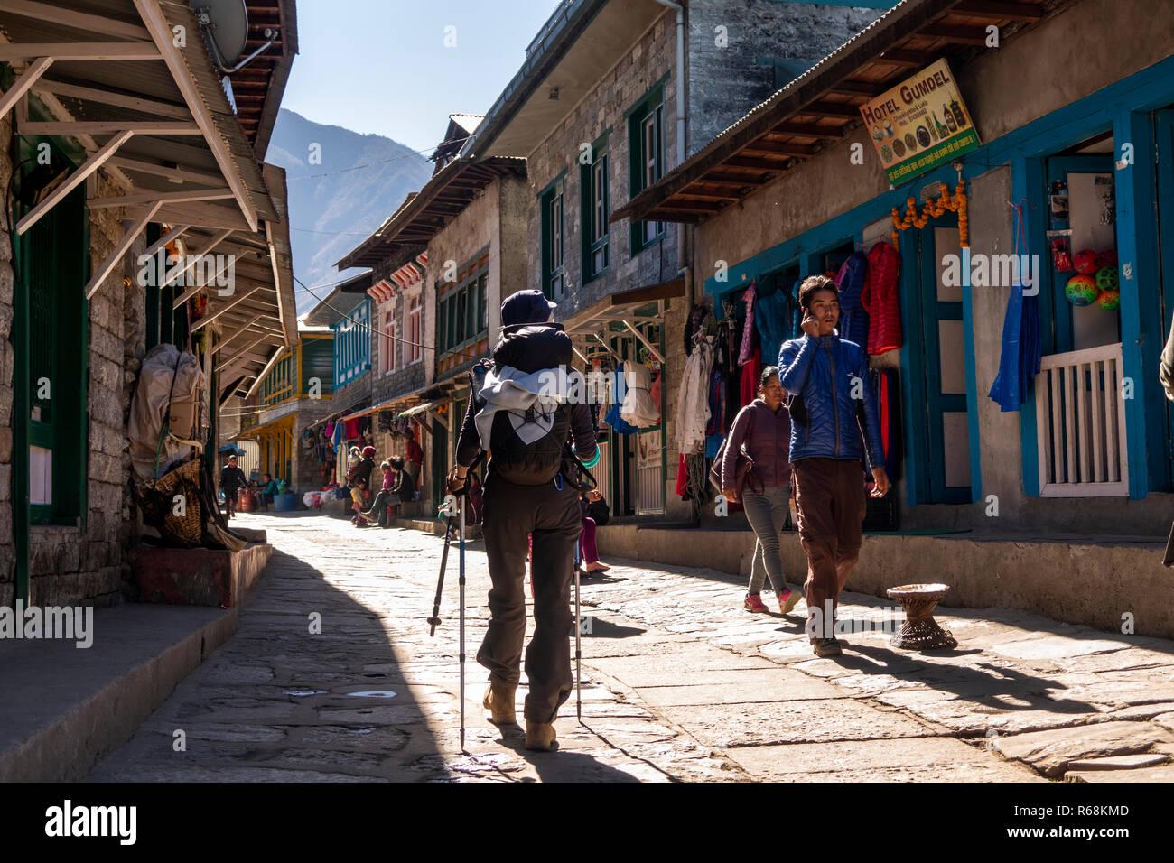 Nepal, Lukla, senior female walker entering town at end of Everest Base Camp Trek - Stock Image