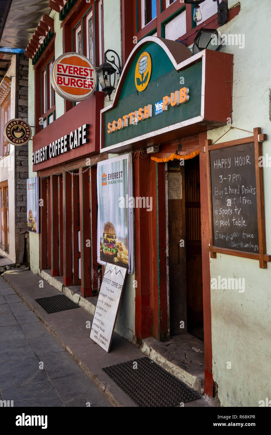Nepal, Lukla, Scottish Pub and Everest Coffee Café in village main street - Stock Image