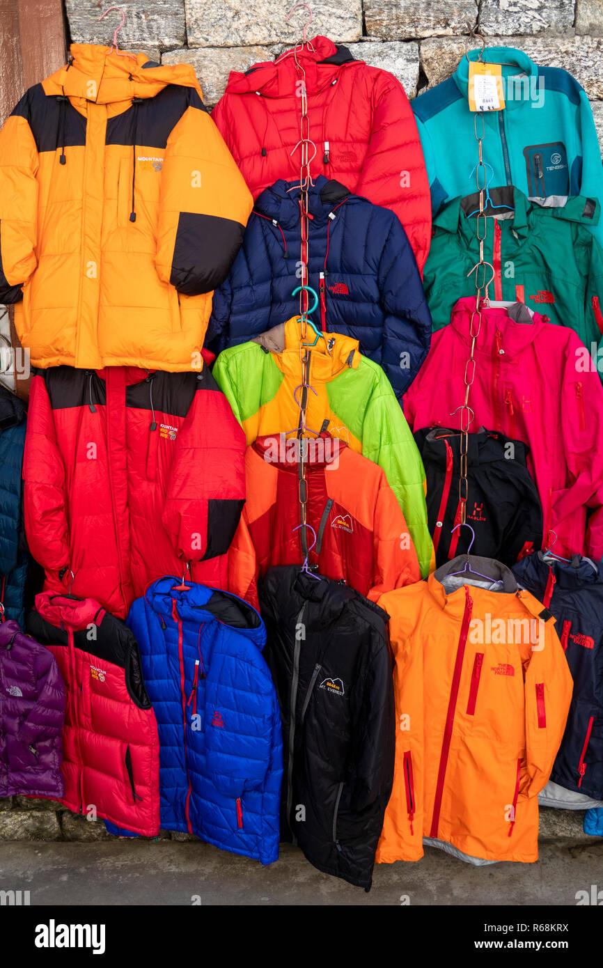 Nepal, Lukla, main street, trekking clothing displayed outside shop - Stock Image