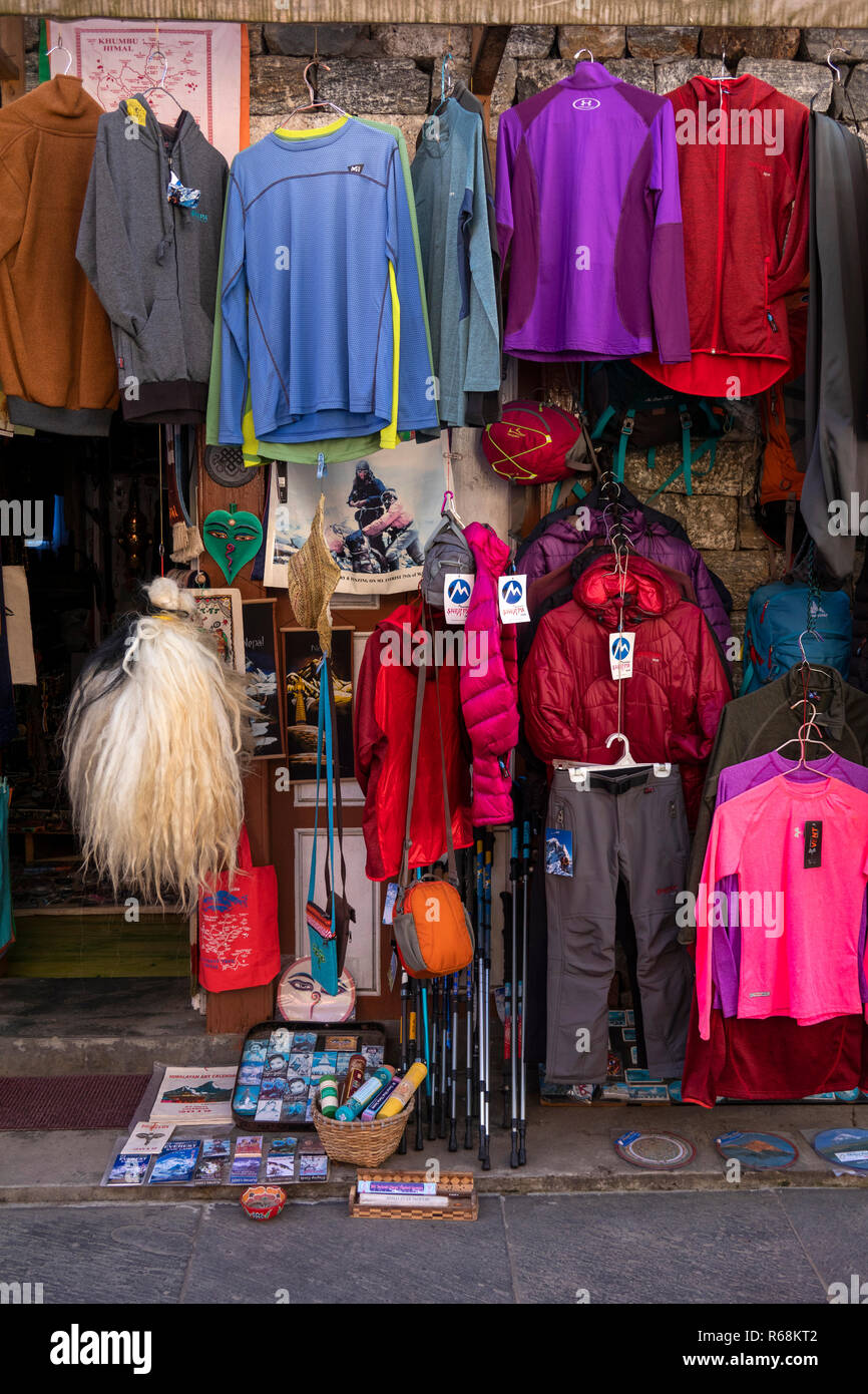 Nepal, Lukla, main street, real and counterfeit trekking clothing displayed outside shop - Stock Image