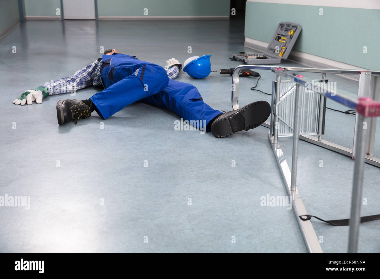 Handyman Fallen From Ladder - Stock Image