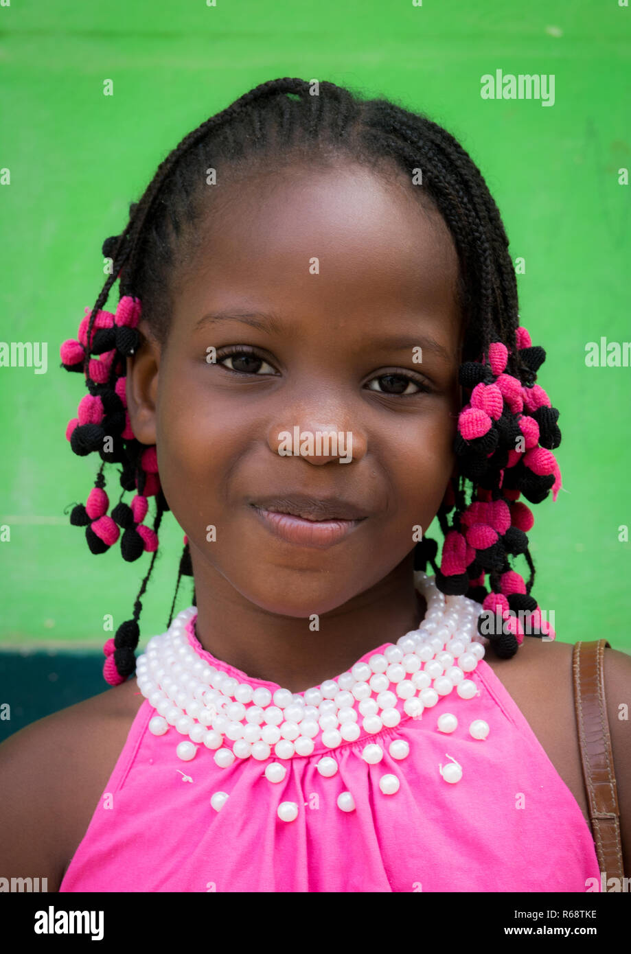 Portrait of a Angolan teenager girl dressed for the church service, Benguela Province, Catumbela, Angola - Stock Image