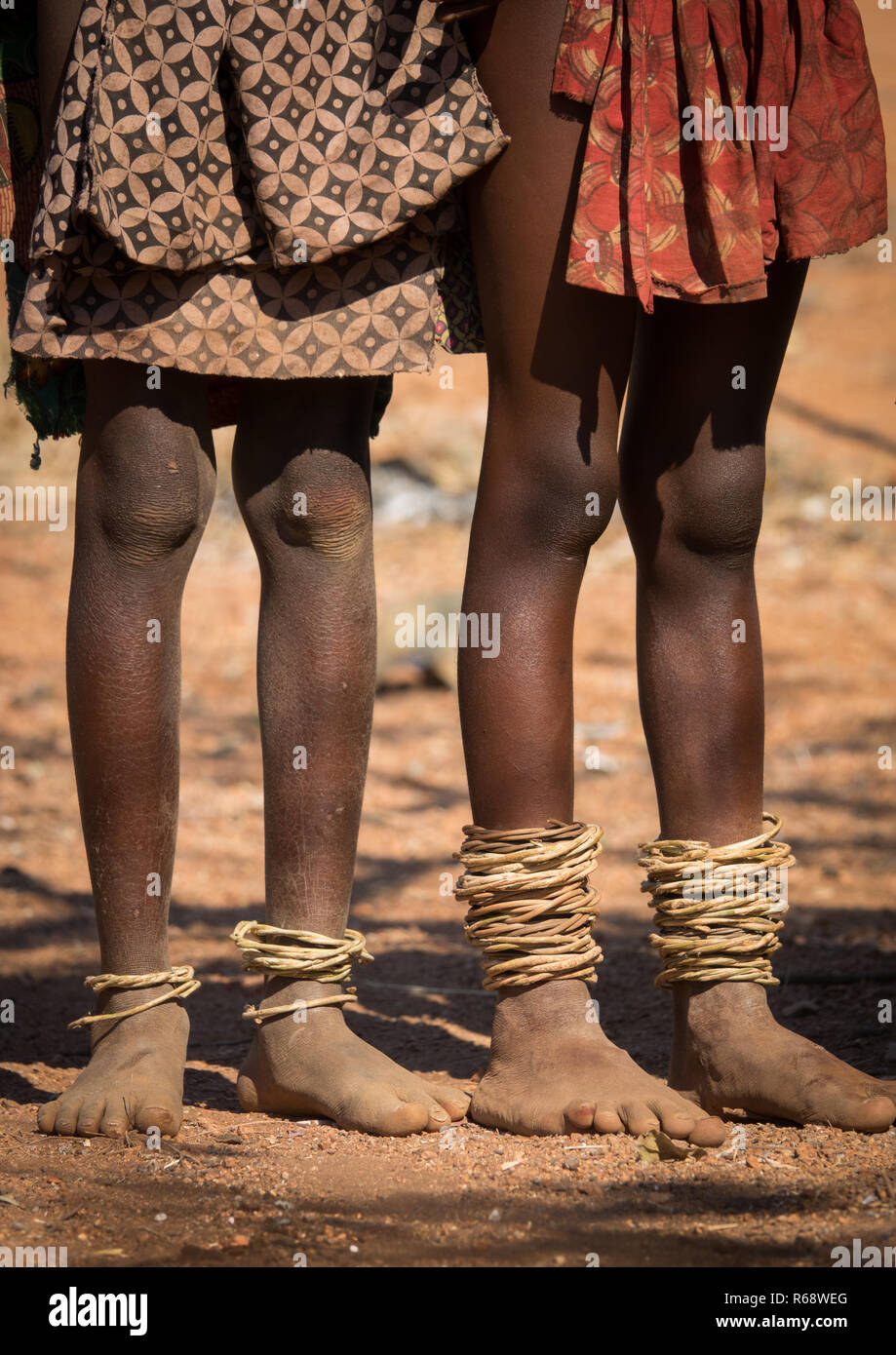 Himba tribe feets with traditional bracelets, Cunene Province, Oncocua, Angola - Stock Image