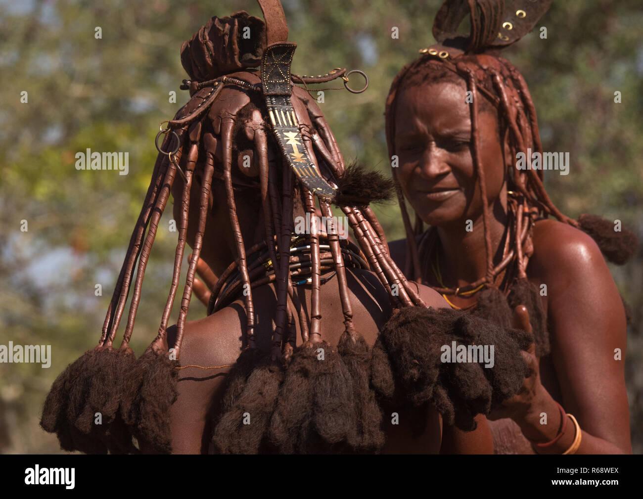 Himba tribe women dancing, Cunene Province, Oncocua, Angola - Stock Image