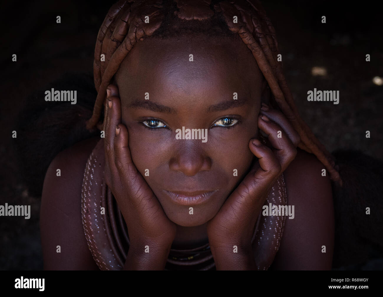 Portrait of a Himba tribe young woman, Cunene Province, Oncocua, Angola - Stock Image
