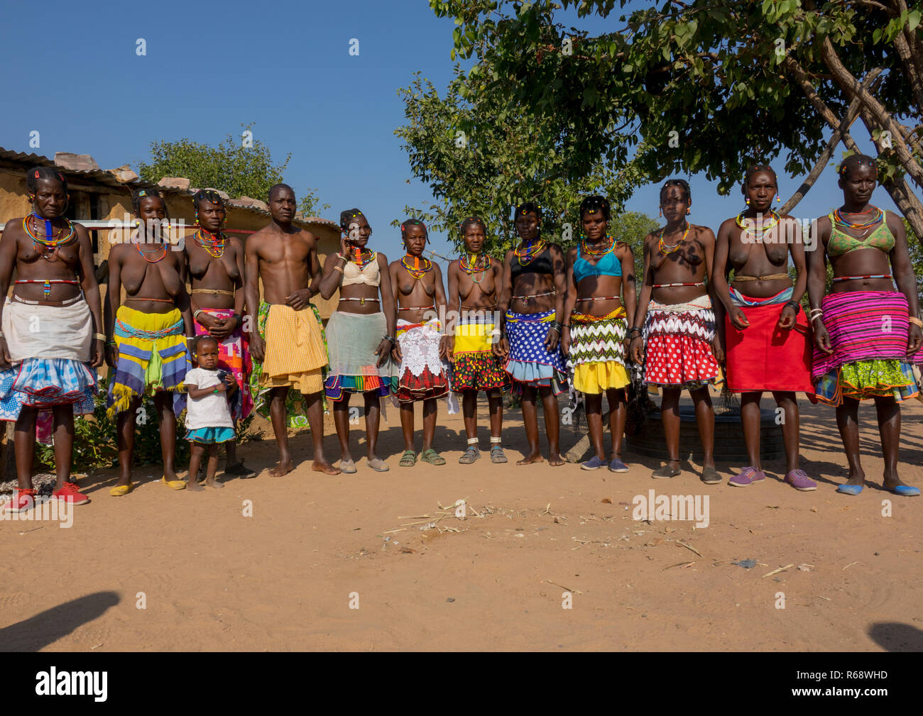 Mudimba tribe relatives with their traditional outfit in their village, Cunene Province, Cahama, Angola - Stock Image