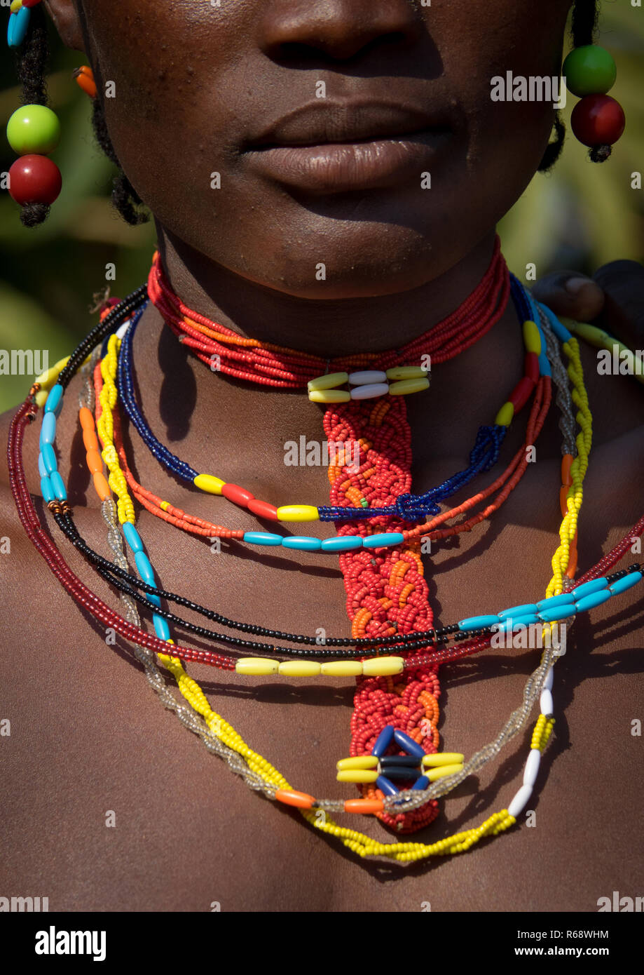 Traditional jewels of Mudimba tribe woman, Cunene Province, Cahama, Angola - Stock Image
