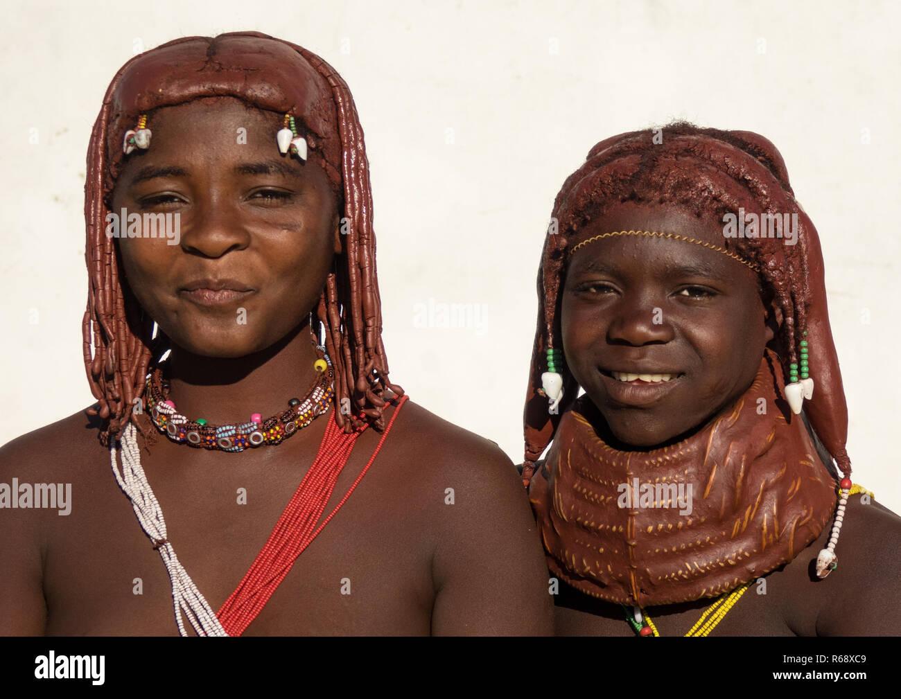Mwila tribe young women with traditional necklace, Huila Province, Lubango, Angola - Stock Image