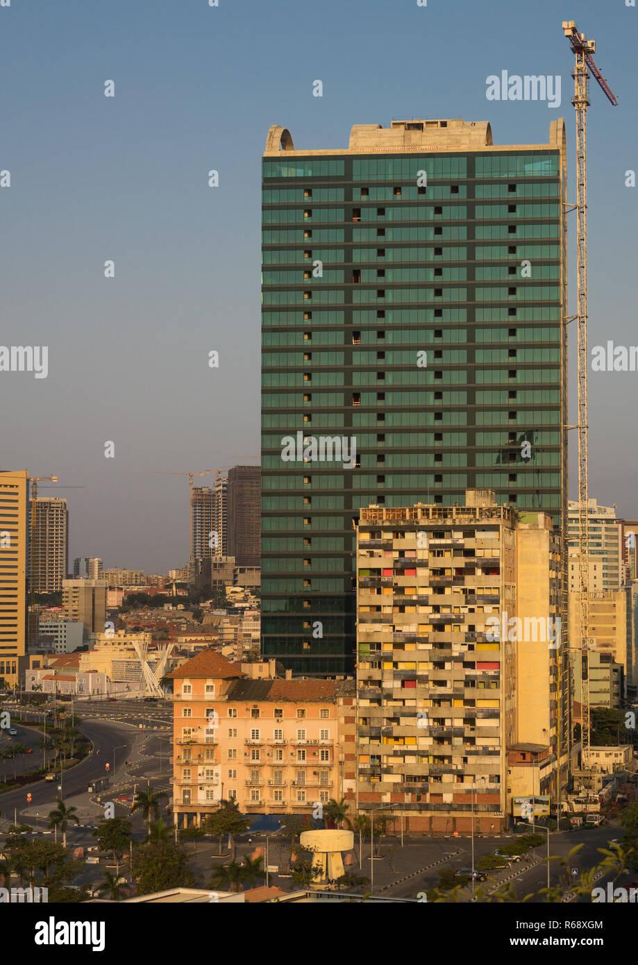 Buildings along the Marginal promenade in Luanda city center at sunset, Luanda Province, Luanda, Angola - Stock Image
