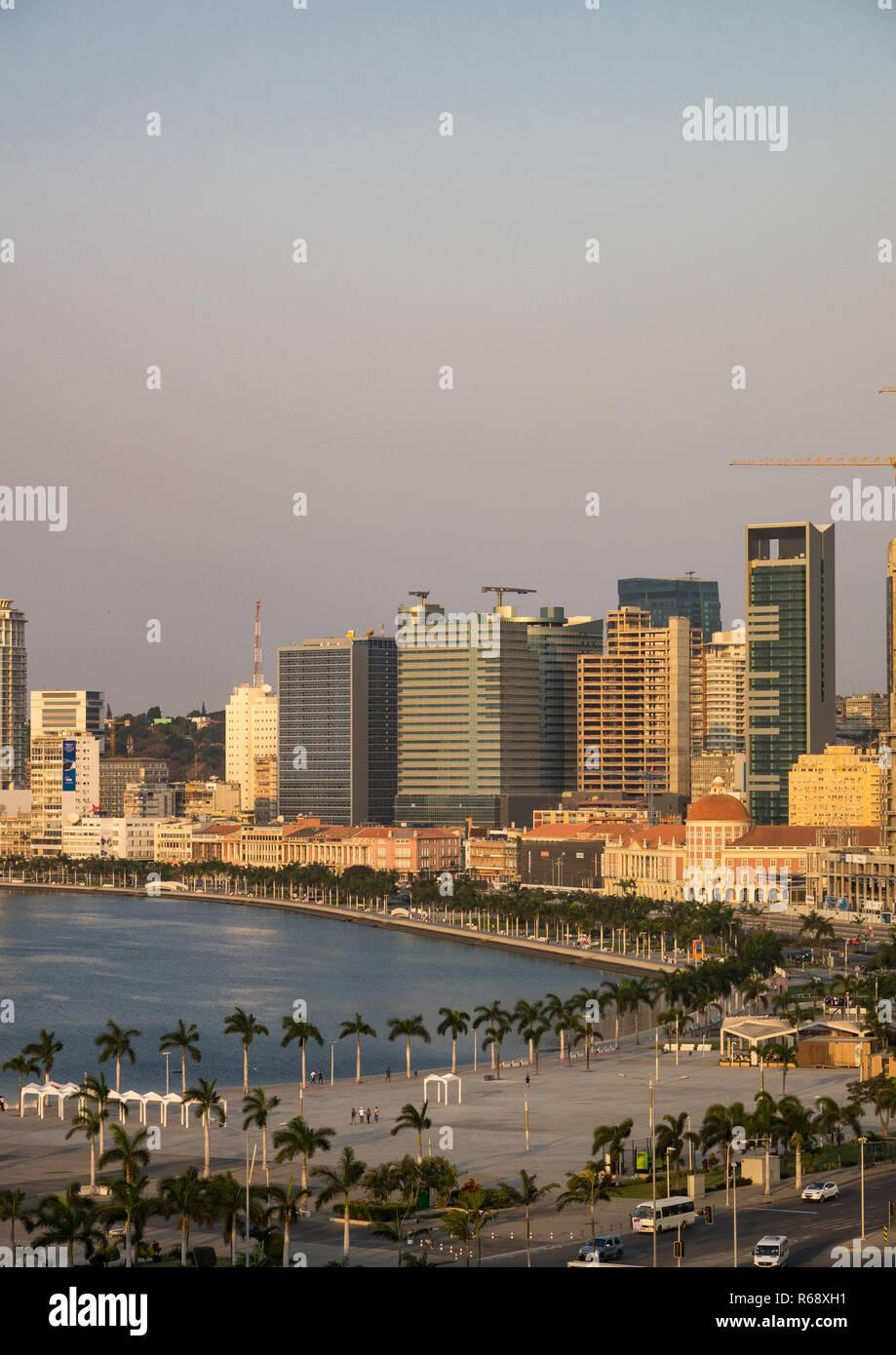 View of the Marginal promenade in Luanda city center at sunset, Luanda Province, Luanda, Angola - Stock Image