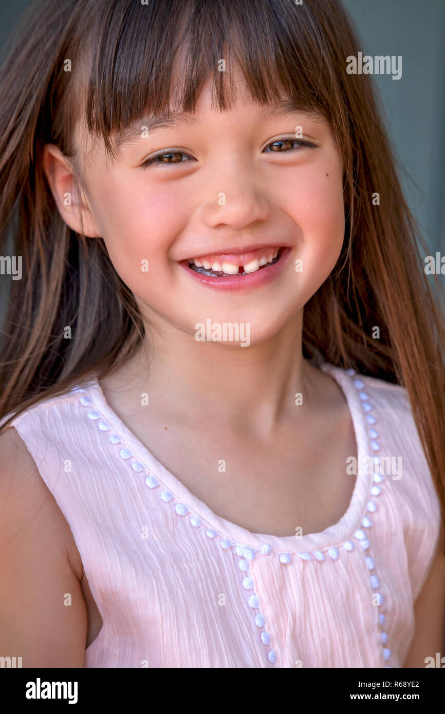 A six year old laughing girl - Stock Image